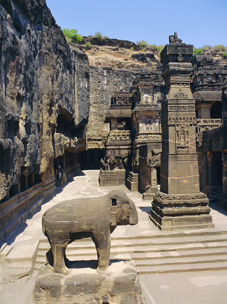 Massive elephant and column in NW of courtyard, Kailasa temple, Ellora, Maharashtra, India