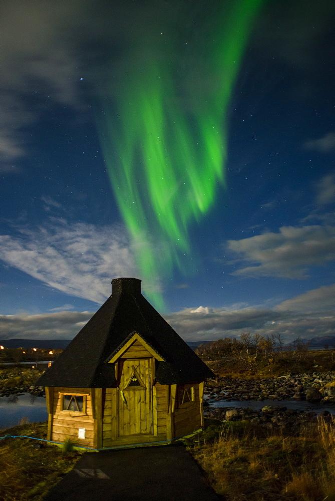 Aurora borealis over lakeside Kota (hut), Kilpisjarvi, Northwest Finland, Lapland, Finland, Scandinavia, Europe - 1200-20