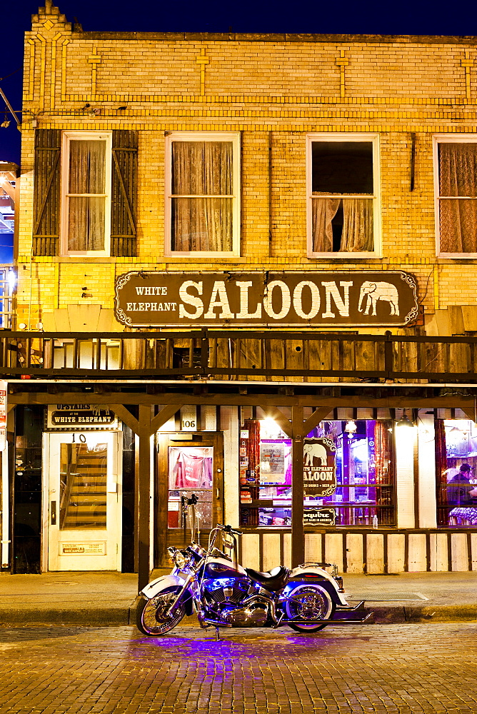 Bike outside a bar in Fort Worth Stockyards at night, Texas, United States of America, North America - 1207-88