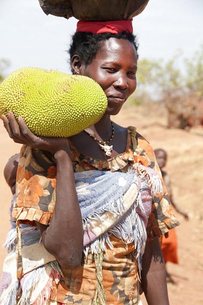 Woman holding a jack fruit, Lira, Uganda, Africa - 1211-19