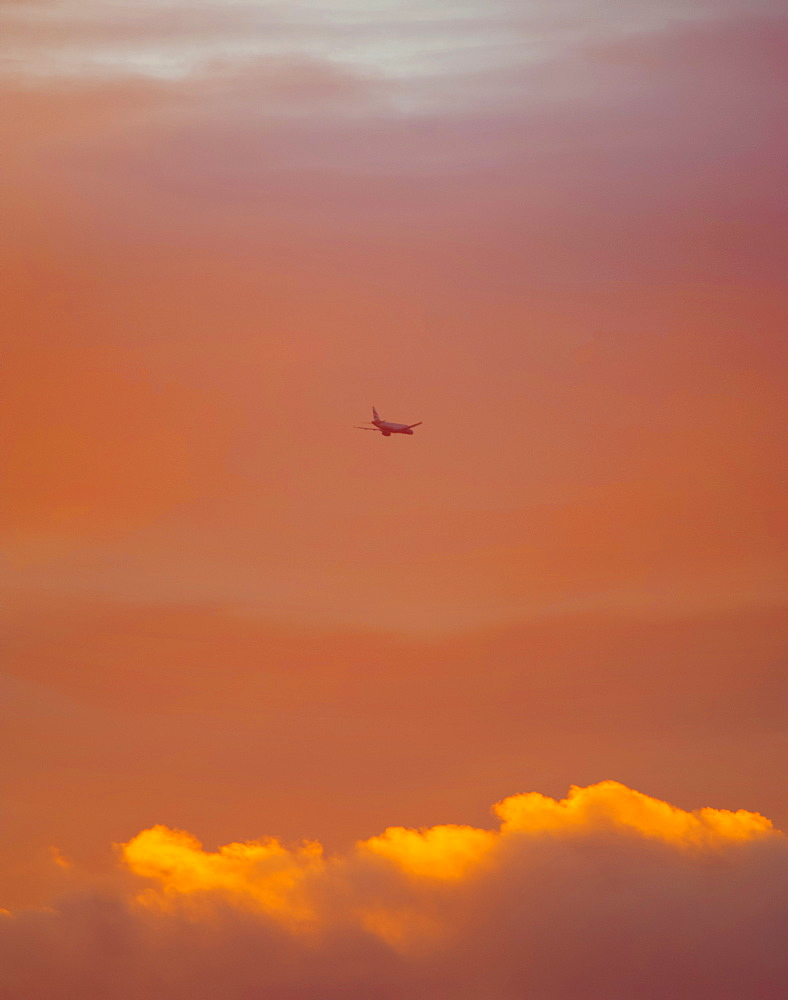 Plane leaving Heathrow at sunset, London, England, United Kingdom, Europe