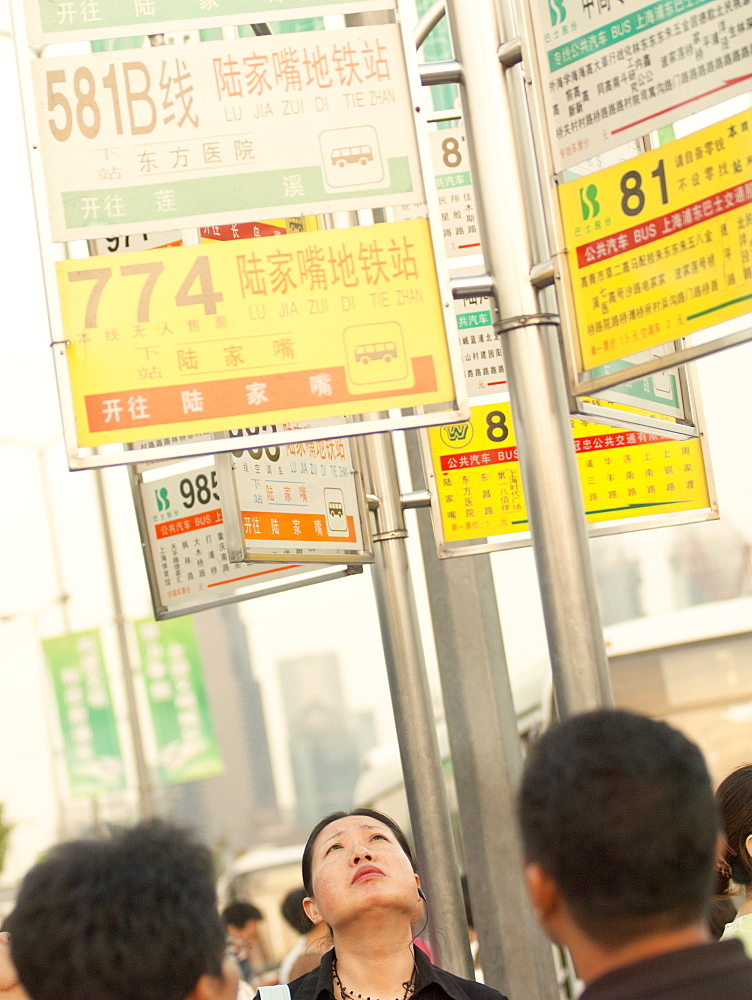Commuters waiting for buses, Shanghai, China, Asia