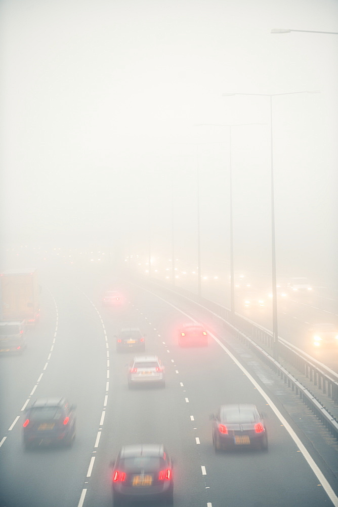 Motorway traffic in thick fog, United Kingdom, Europe
