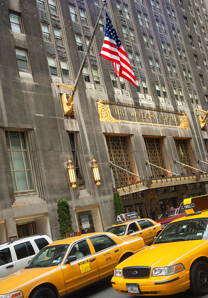 The Waldorf Astoria Hotel and yellow taxis, New York, United States of America, North America - 1212-330