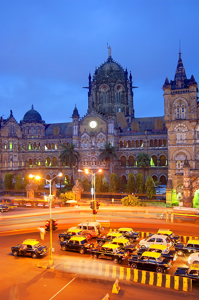Taxis and Victoria Terminus, Mumbai (Bombay), India, South Asia