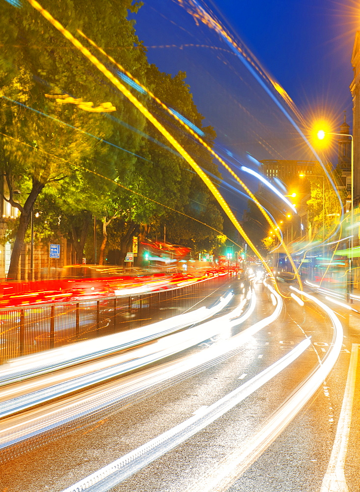 Streams of car headlights at night, London, England, United Kingdom, Europe