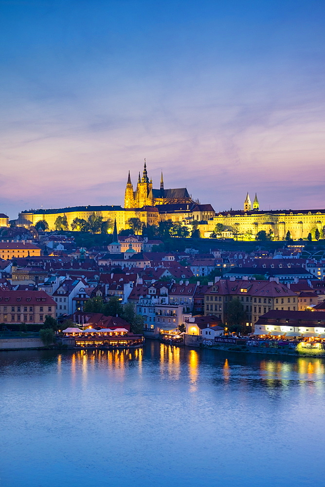 Czech Republic, Prague. Charles Bridge and Pague Castle on the Vltava River at dusk, from Old Town Bridge Tower.