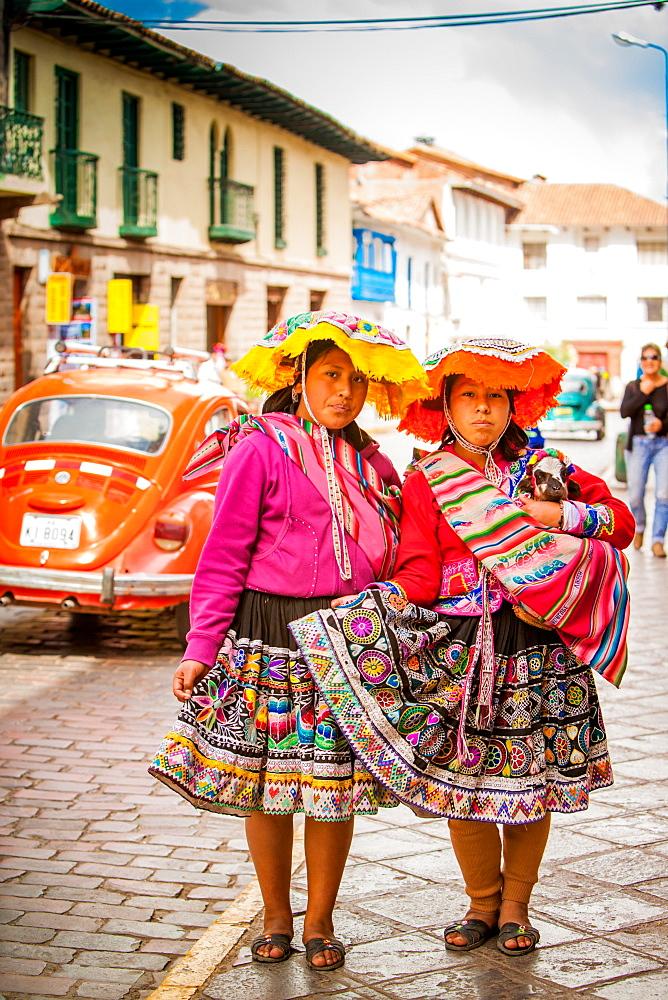 Two Cholita Peruvian girls and their lambs, Cusco, Peru, South America