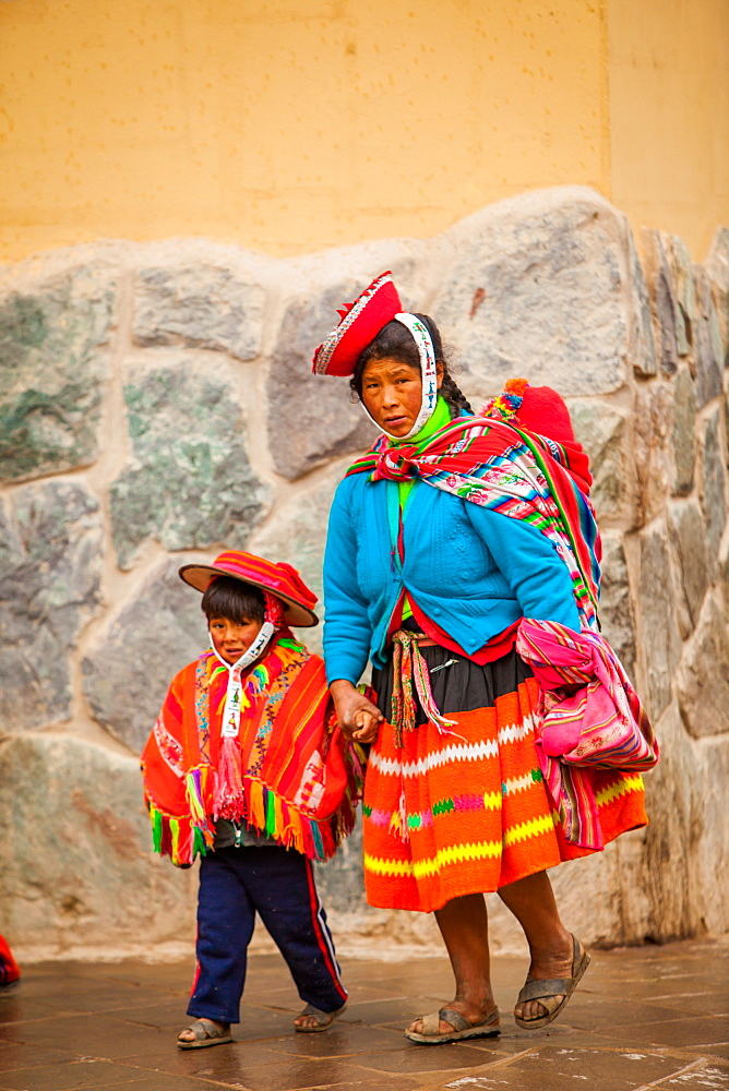 Traditional Peruvian Incan woman and her son, Ollantaytambo, Peru, South America