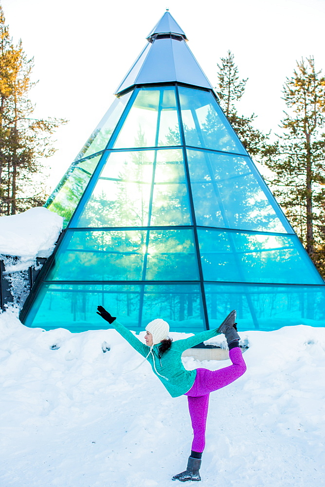 Woman doing yoga, glass teepee, Kakslauttanen Igloo Village, Saariselka, Finland, Scandinavia, Europe