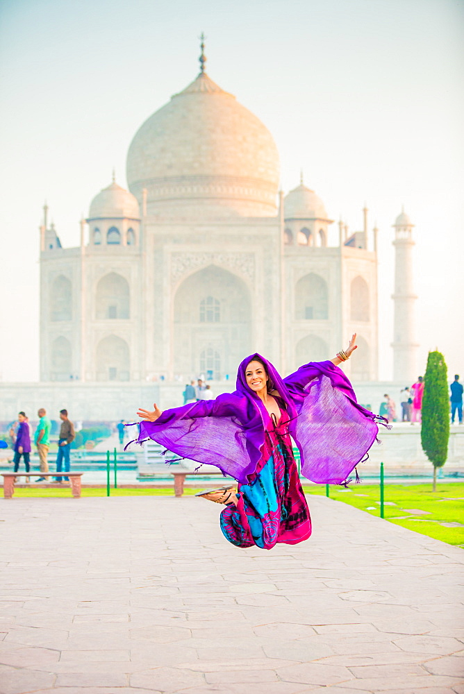 Laura Grier jumping at the Taj Mahal, UNESCO World Heritage Site, Agra, Uttar Pradesh, India, Asia