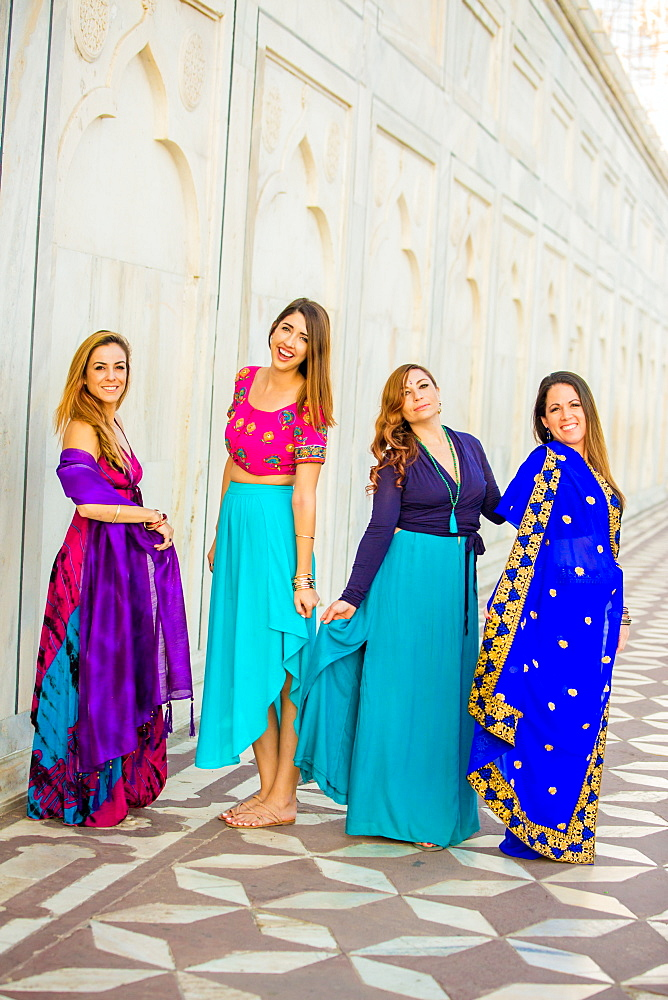 Tourists in saris standing in front of the Taj Mahal, Agra, Uttar Pradesh, India, Asia