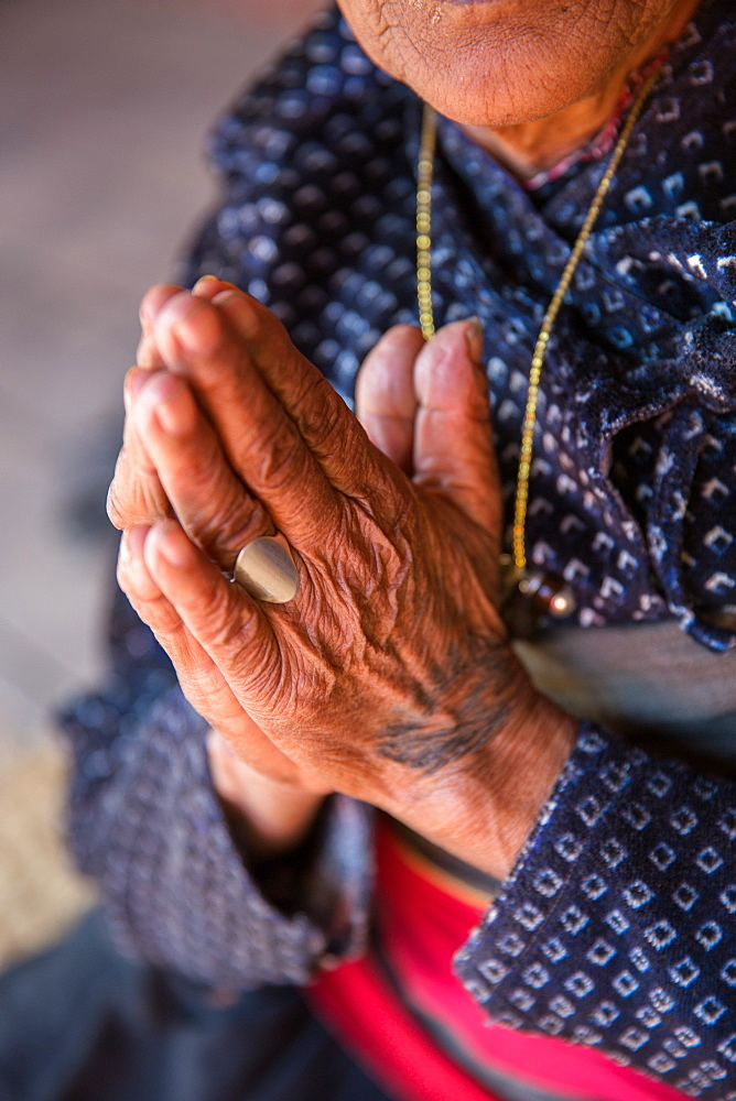 Old woman's hands praying, Bhaktapur, Nepal, Asia