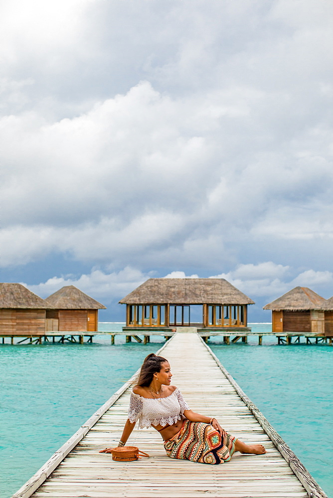 Relaxing at the Conrad Maldives Rangali Island over water yoga studio, Maldives, Indian Ocean, Asia