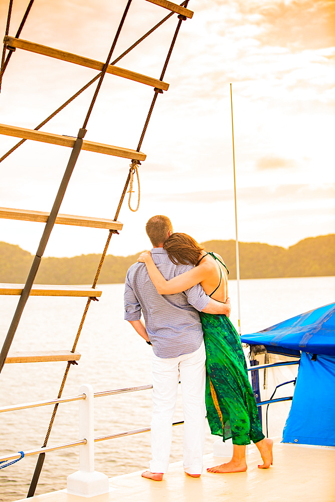 Couple enjoying the sunset on the Palau Siren, Koror Island, Palau, Micronesia, Pacific