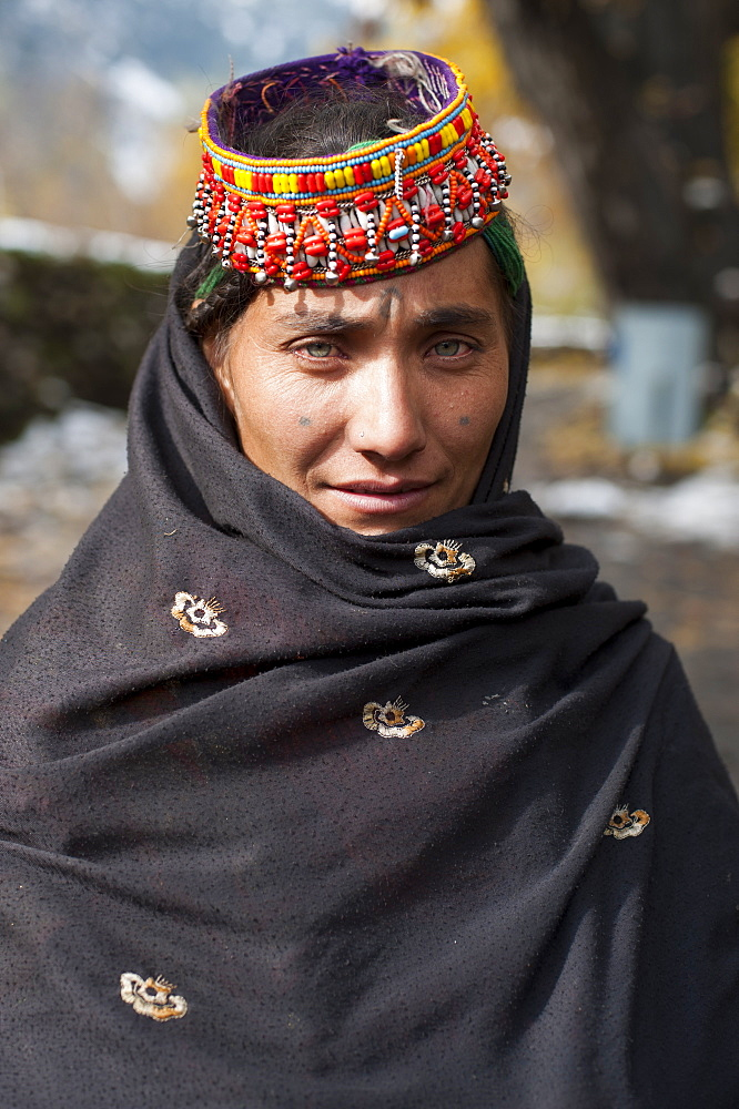 A Kalasha woman wearing traditional clothes, North West Frontier Province, Pakistan, Asia