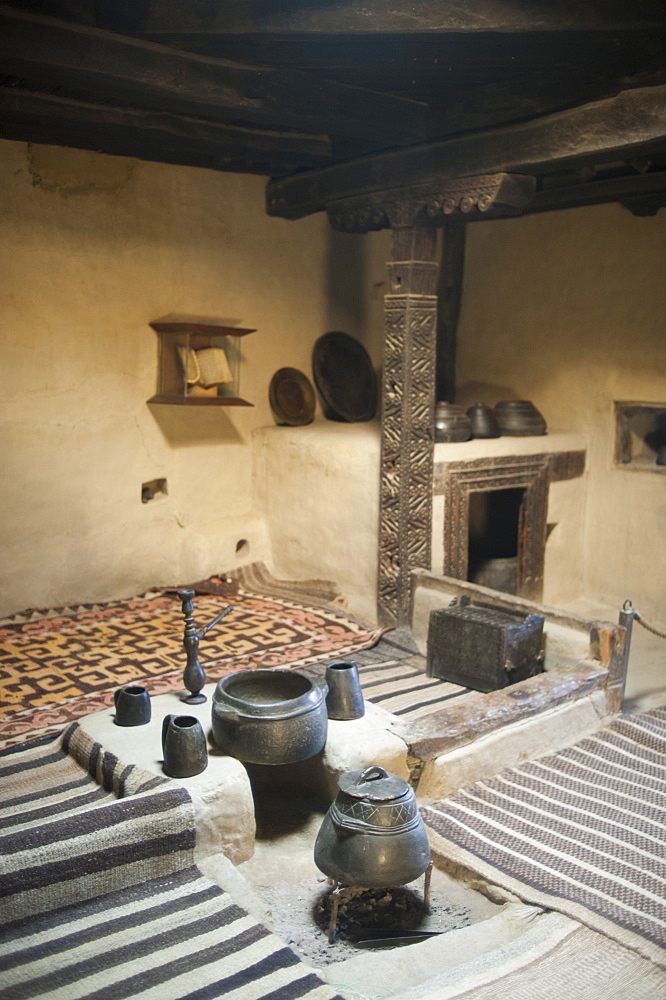 A ancient style kitchen with stone pots on display in a museum in the Hunza Valley, Gilgit-Baltistan, Pakistan, Asia