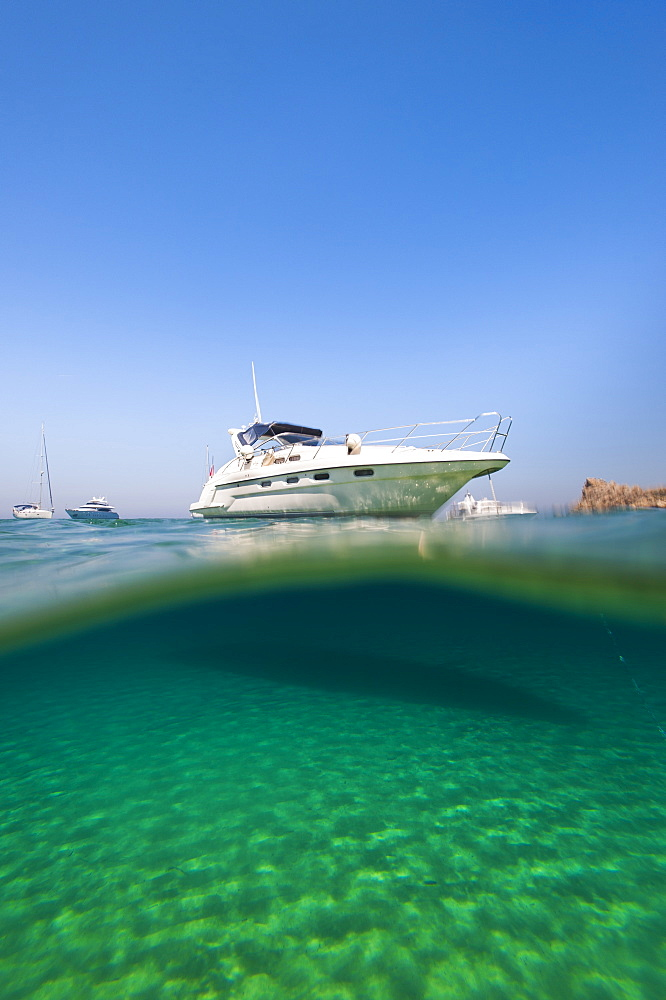 A speedboat moored at San Blas Bay in off the island of Gozo near Malta
