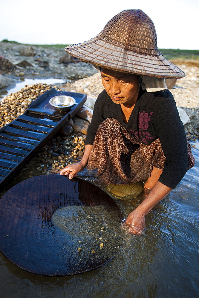 A Burmese woman panning for gold in a small stream near Putao in the north, Kachin State, Myanmar (Burma), Asia
