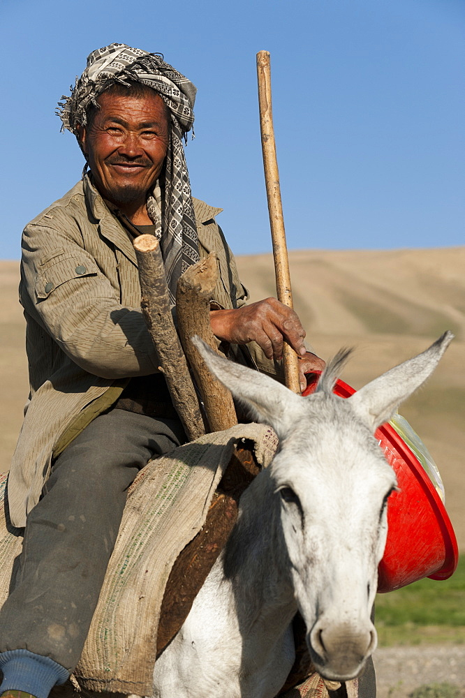 An Afghan farmer smiles for the camera in Bamiyan province in Afghanistan