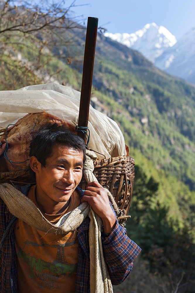 A porter makes his daily journey from Lukla to Namche, Himalayas, Nepal, Asia