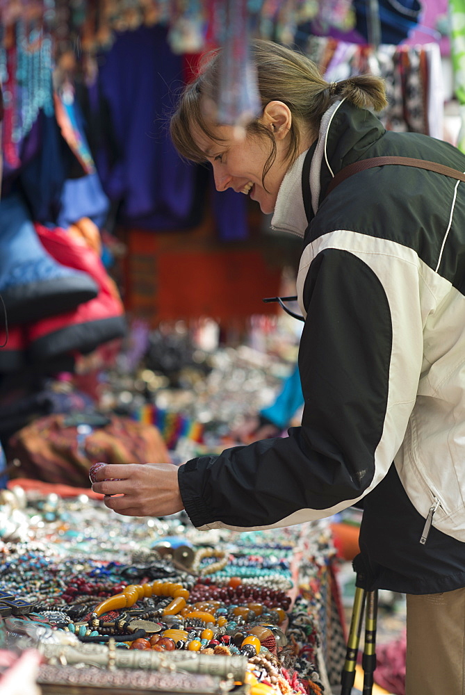 Shopping for souvenirs in Namche Bazaar, the main town during the Everest base camp trek, Khumbu Region, Nepal, Asia