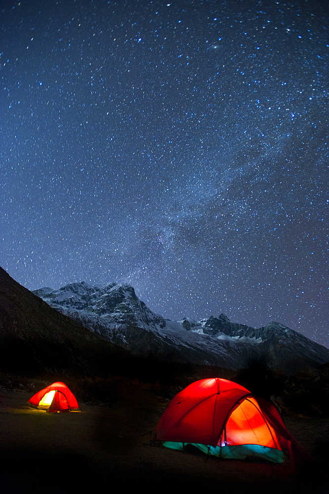 Glowing tents at Samogaon on the Manaslu circuit trek, Himalayas, Nepal, Asia