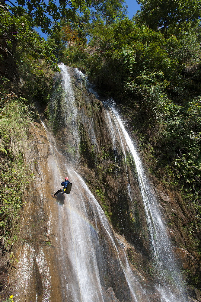 Canyoning in a waterfall in Nepal, Asia
