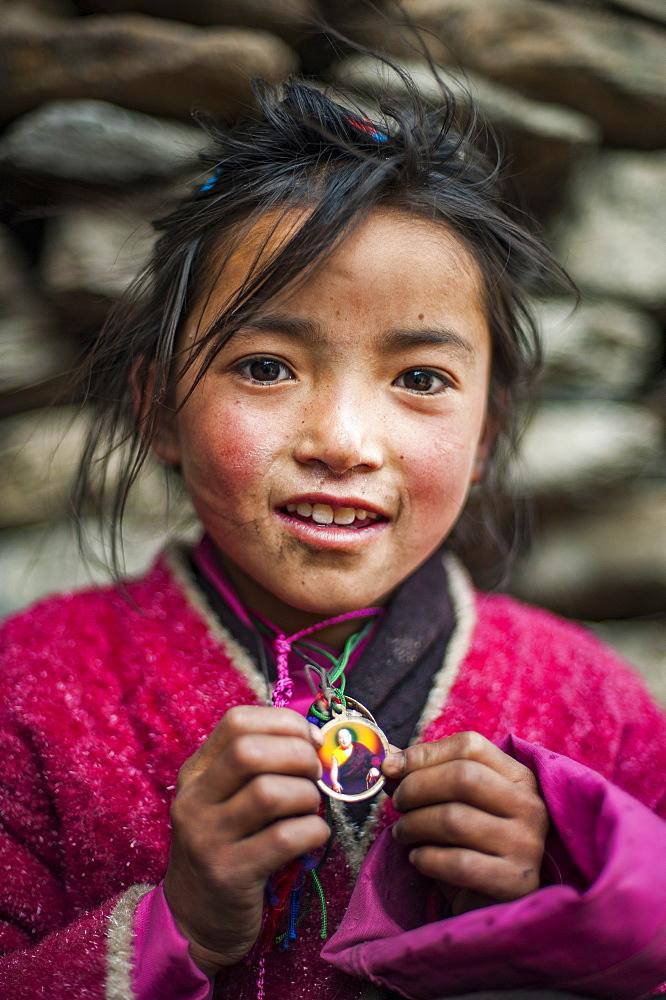 A little Buddhist girl in the Tsum Valley, Manaslu region, Nepal, Asia