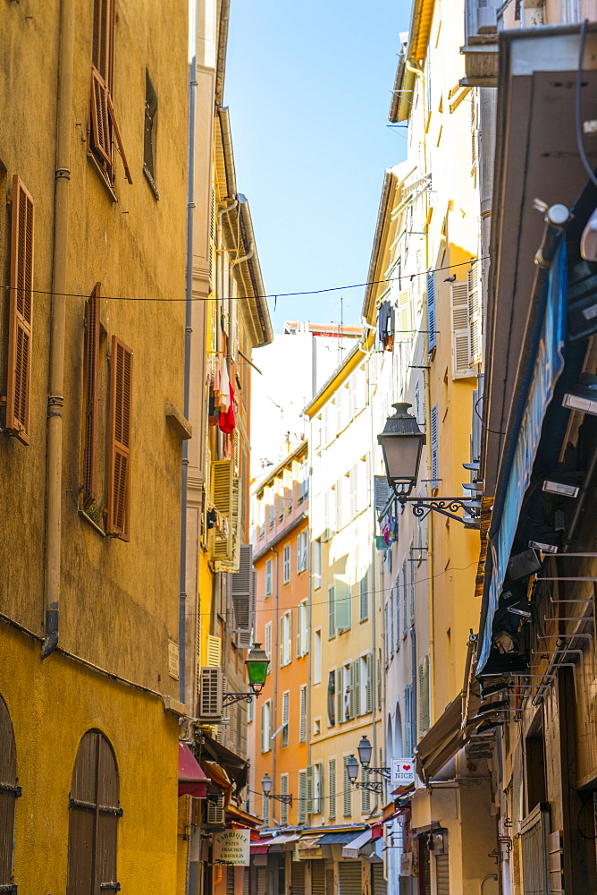 Narrow street in the Old Town, Vieille Ville, Nice, Alpes-Maritimes, Cote d'Azur, Provence, French Riviera, France, Mediterranean, Europe