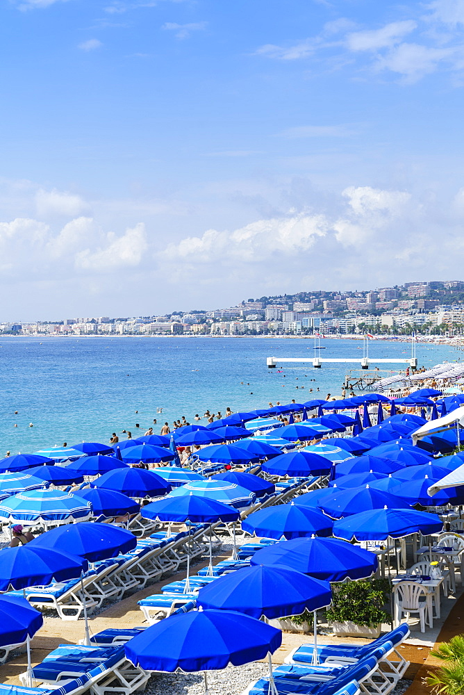 Blue parasols on the beach, Promenade des Anglais, Nice, Alpes Maritimes, Cote d'Azur, Provence, France, Mediterranean, Europe