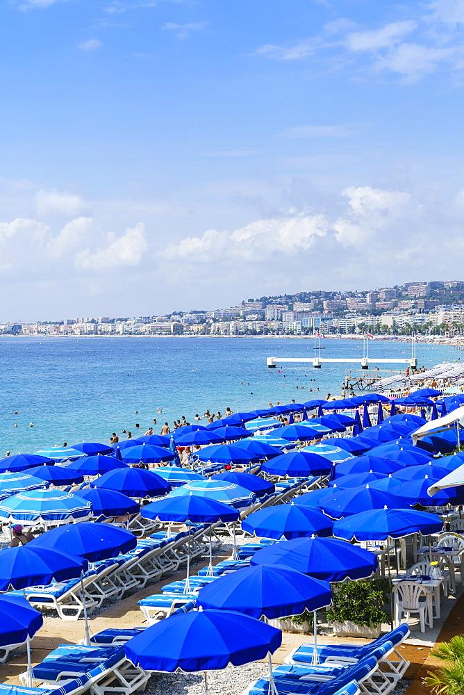 Blue parasols on the beach, Promenade des Anglais, Nice, Cote d'Azur, France