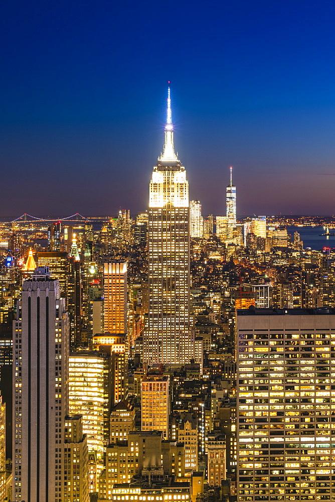 Manhattan skyline and Empire State Building at dusk, New York City, USA