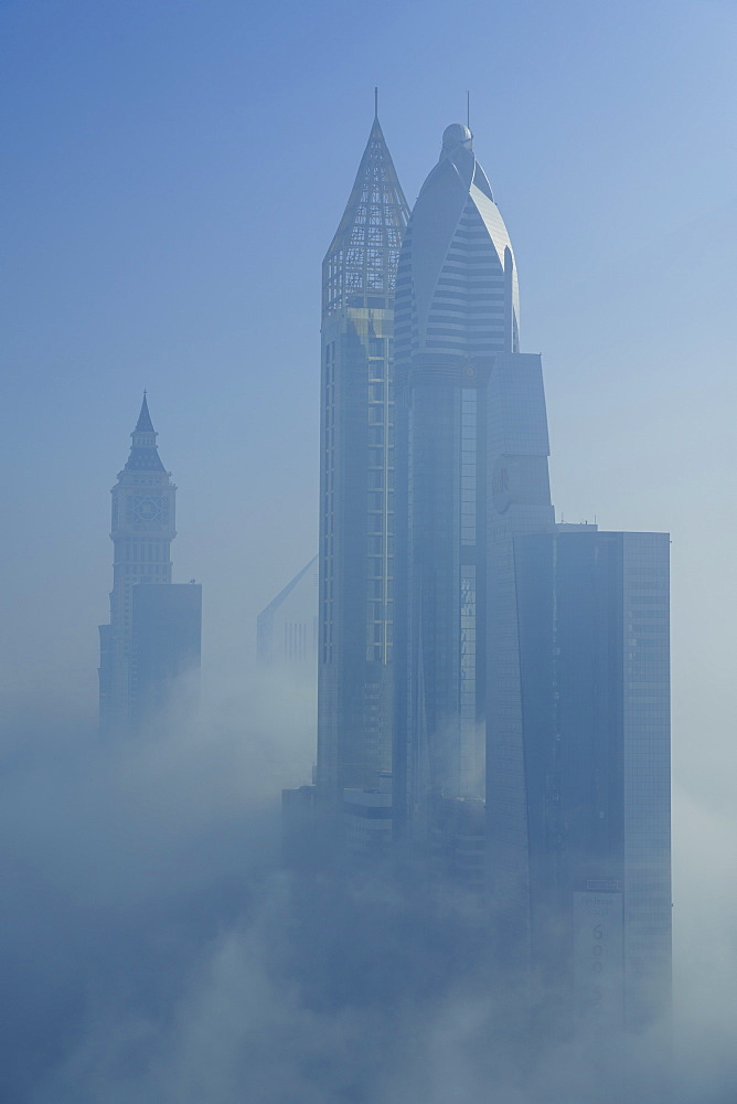 A foggy morning shrouds skyscrapers in Dubai, United Arab Emirates, Middle East