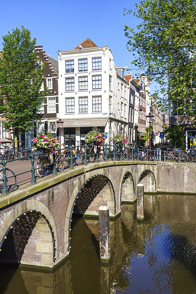 Bicycles on a bridge over the Herengracht canal, Amsterdam, North Holland, The Netherlands, Europe