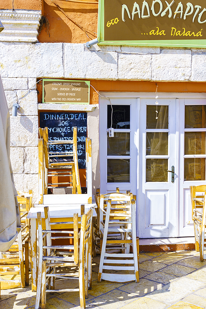 Taverna table and chairs, Gaios, Paxos, Ionian Islands, Greek Islands, Greece, Europe