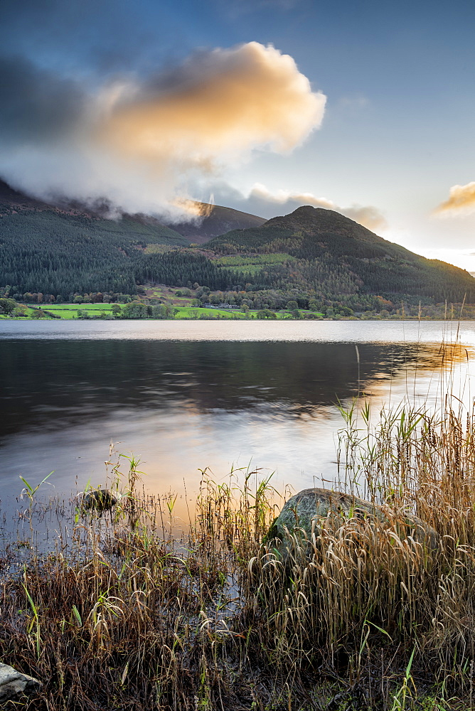 Early morning sunlight over lower slopes of Skiddaw and Bassenthwaite, Lake District National Park, UNESCO World Heritage Site, Cumbria, England, United Kingdom, Europe - 1228-185