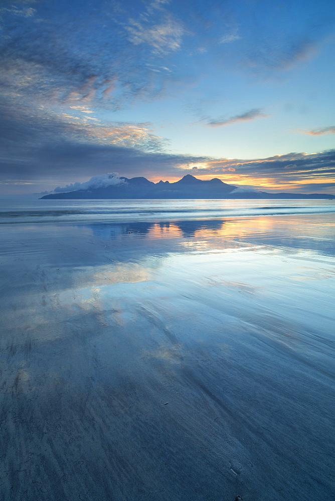 Sunset over the Isle of Rhum, from Bay of Laig, Scotland, United Kingdom, Europe
