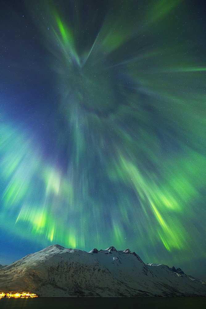 A coronal burst of aurora borealis (Northern Lights) during a solar storm in Northern Norway above a snowy mountain, Norway, Scandinavia, Europe - 1229-3