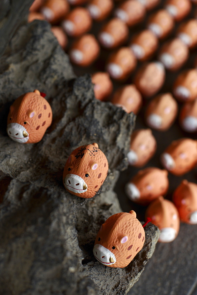 Small porcelain hogs as votive offerings, Marishisonten-do temple, Kyoto, Japan, Asia