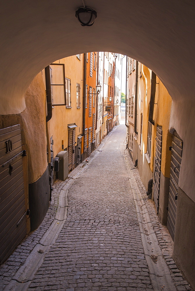 Arch and cobblestone alley in historic Gamla Stan, Stockholm, Sweden, Scandinavia, Europe