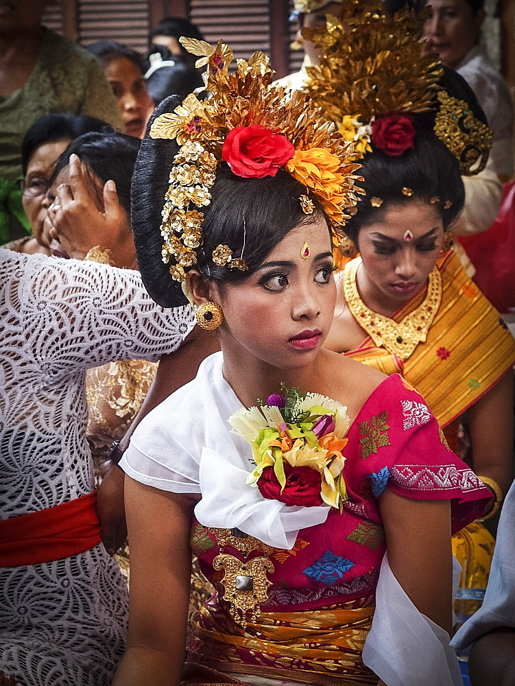 Girl awaiting tooth filing ceremony, Denpasar, Bali, Indonesia, Southeast Asia, Asia