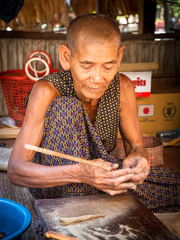 Old woman making incense, village home near Siem Reap, Cambodia, Indochina, Southeast Asia, Asia