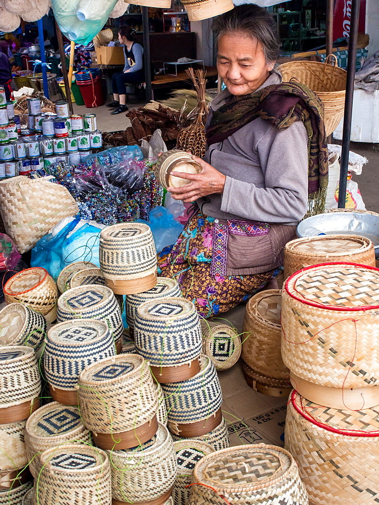 Woman selling baskets for sticky rice in central outdoor market, Luang Prabang, Laos, Indochina, Southeast Asia, Asia - 1242-214