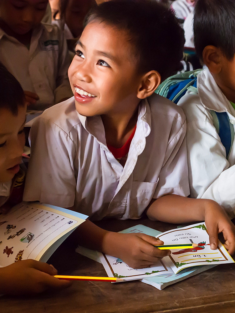 Young boy in school classroom, Houy Mieng, Laos, Indochina, Southeast Asia, Asia