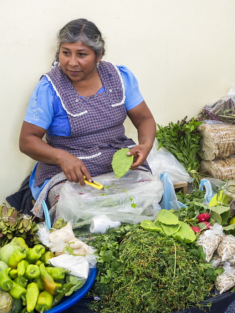 Woman selling green produce at a traditional market, Oaxaca, Mexico, North America