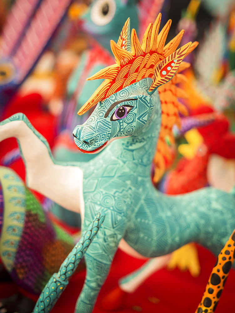 Colorful carved wooden figure (alebrije) of a horse, Oaxaca valley, Oaxaca, Mexico, North America