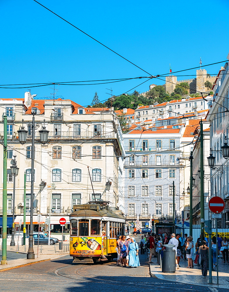 Traditional yellow tram at Praca da Figueira with Castelo Sao Jorge at background, Lisbon, Portugal, Europe - 1243-330