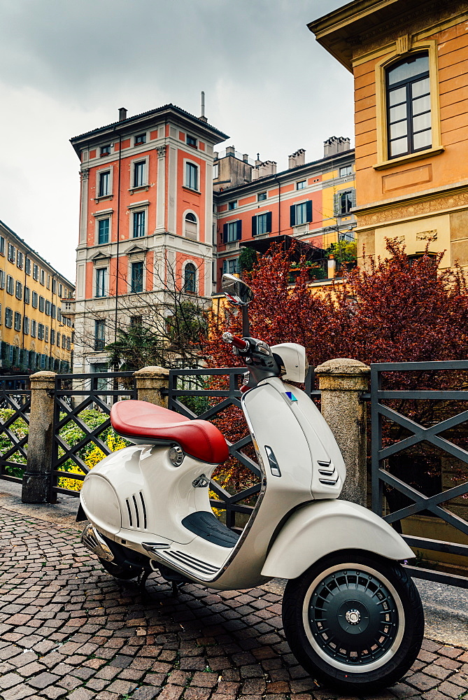 Italian Vespa with typical Milan-style architecture, Milan, Lombardy, Italy, Europe