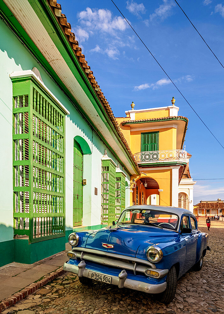 Vintage car on the cobbled street of Trinidad, Sancti Spiritus Province, Cuba, West Indies, Caribbean, Central America